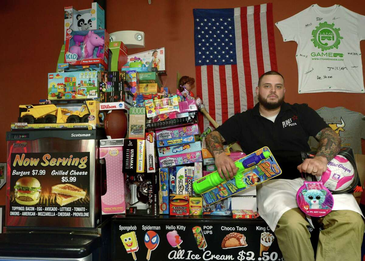 Dave Kuban, the owner of Planet Pizza, in his store on Main Avenue Thursday, November 30, 2017, in Norwalk, Conn, Kuban is hosting a toy drive for the Department of Children and Families for the second year running. Local businesses from the area have joined in the effort to help provide children at the shelter with something to unwrap on Christmas day