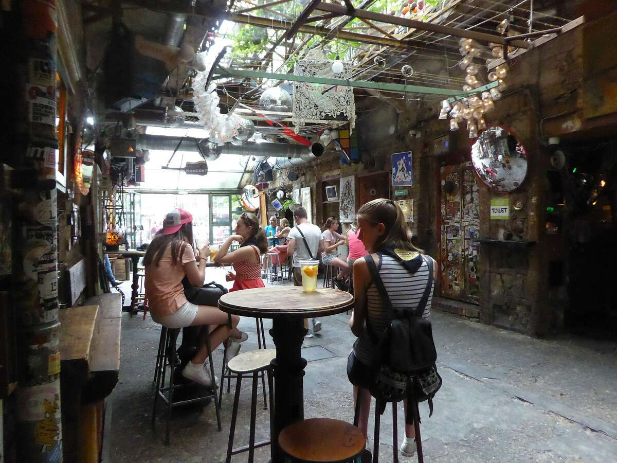 Szimpla Kert bar is a popular gathering spot in Budapest.