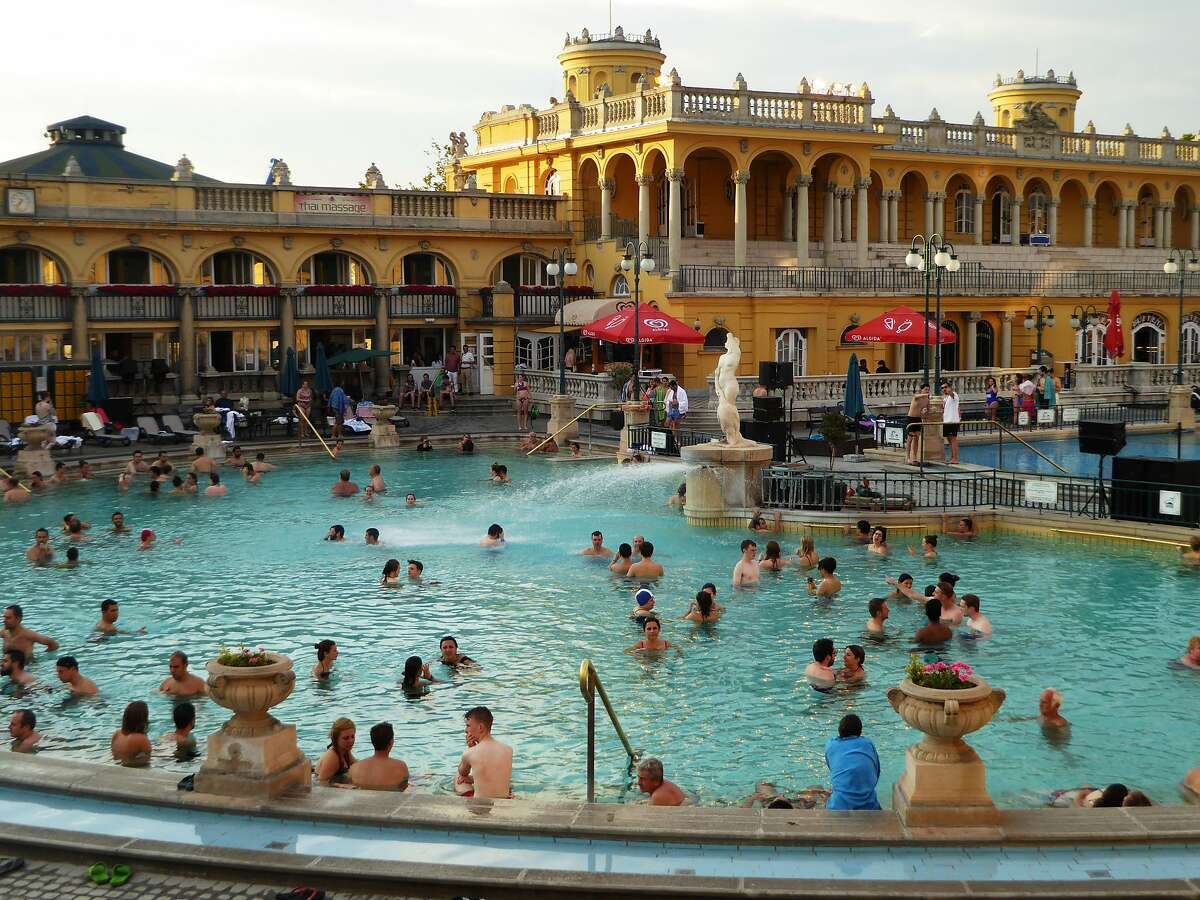 Bathers take in the waters at Szechenyi Thermal Baths, a massive baths and pool complex in Budapest.