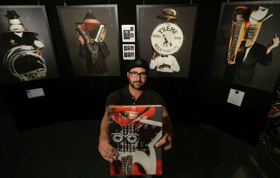 Photographer Michael Weintrob with his traveling exhibit supporting his book tour, Instrumenthead, which was published in April, at The Factory Underground on Friday in Norwalk. Photo: Erik Trautmann / Hearst Connecticut Media / Norwalk Hour