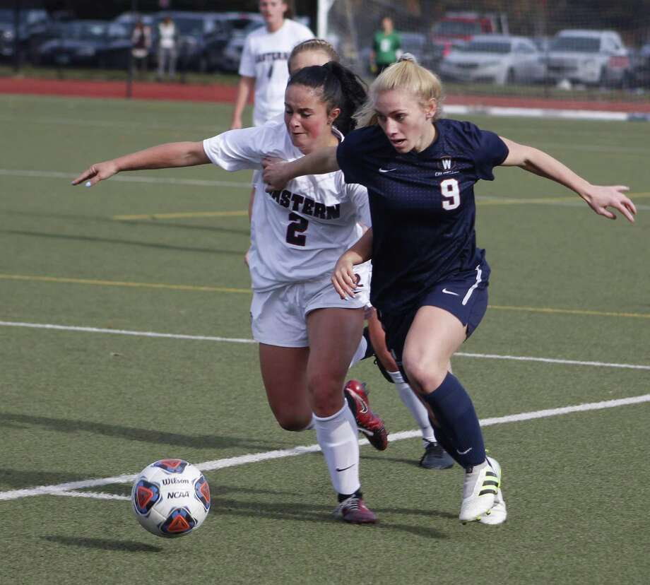 Western Connecticut's Autumn Sorice, right, races toward the goal as Eastern Connecticut'sAlexa Moustakakis defends during the Little East Conference women's soccer championship match in Mansfield Nov. 4, 2017. Photo: Richard Gregory / Richard Gregory