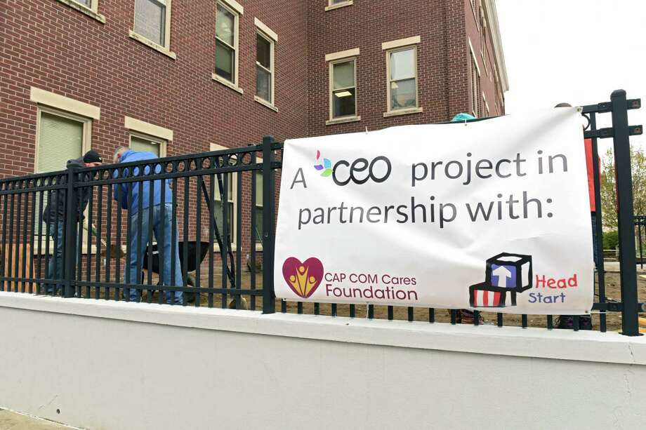 A team of volunteers from CAP COM Federal Credit Union and the CAP COM Cares Foundation donate their time and effort to rehabilitate one of two of Commission on Economic Opportunity's Head Start playgrounds at CEOOs Community Resource Center on Friday, Dec. 1, 2017 in Troy, N.Y. (Lori Van Buren / Times Union) Photo: Lori Van Buren / 20042282A