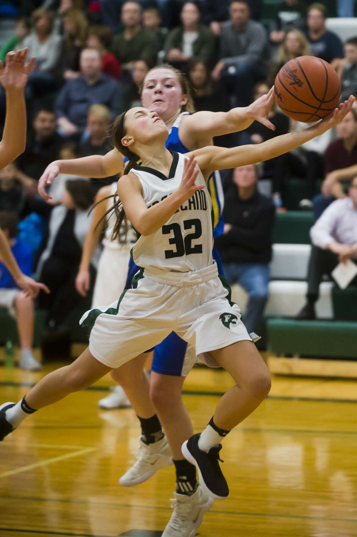Freeland senior Kaylee Argyle takes a shot as Midland senior Maddie Barrie tries to block her during their game on Friday, Dec. 1, 2017 at Freeland High School. (Katy Kildee/kkildee@mdn.net)