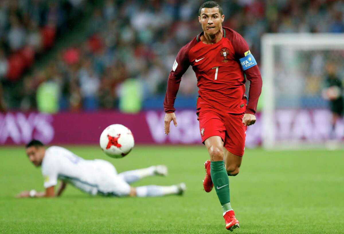 FILE - In this Wednesday, June 28, 2017 filer, Portugal's Cristiano Ronaldo keeps his eyes on the ball during the Confederations Cup, semifinal soccer match between Portugal and Chile, at the Kazan Arena, Russia. (AP Photo/Pavel Golovkin, File) ORG XMIT: FP125