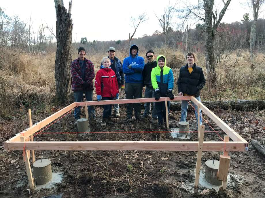 Boy Scout Joseph H. Sefcik began work on his Eagle Scout Project Sunday, Nov.12, at the Bull Pond Preserve for the Harwinton Land Trust. From left are Ed Pitcher (Troop 35), Mallory Sefcik, Rob Maeder (Troop 35), Joey Sefcik, Joe Sefcik, Matthew Sefcik (Troop 35), and Kevin Maeder (Troop 35). Not pictured are Harris Ahmed (Troop 274 Avon), and Harwinton Land Trust members Dan Lyga, Eric Rahn, Larry Connors, and Bob Orciari. Photo: Contributed Photo /Not For Resale