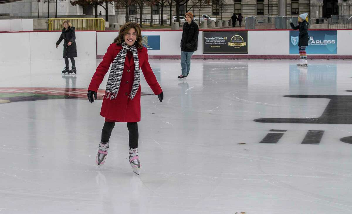 The ice skating rink in the Empire State Plaza is officially open for business after a brief ceremony with Lt. Governor Kathy Hochul, center, Friday Dec 1, 2017 in Albany, NY. (Skip Dickstein/ Times Union)