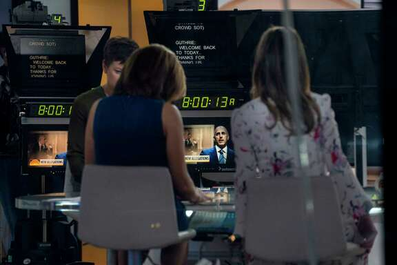 """Co-anchors Hoda Kotb, left, and Savannah Guthrie prepare for a news segment of the """"Today"""" show Thursday in New York as the firing of long-time show anchor and host Matt Lauer continues to reverberate."""