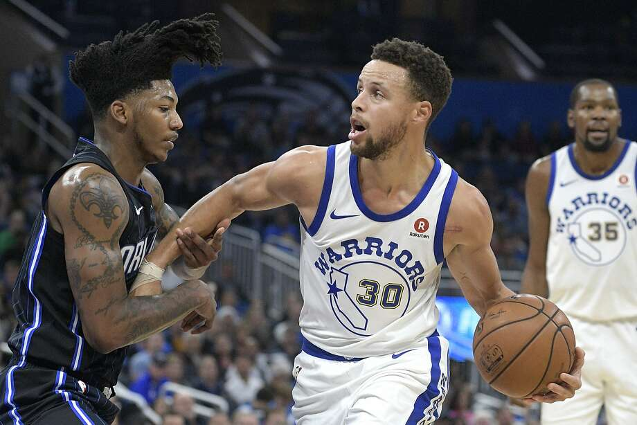 Golden State Warriors guard Stephen Curry (30) is fouled by Orlando Magic guard Elfrid Payton, left, while driving to the basket during the first half of an NBA basketball game Friday, Dec. 1, 2017, in Orlando, Fla. (AP Photo/Phelan M. Ebenhack) Photo: Phelan M. Ebenhack, Associated Press