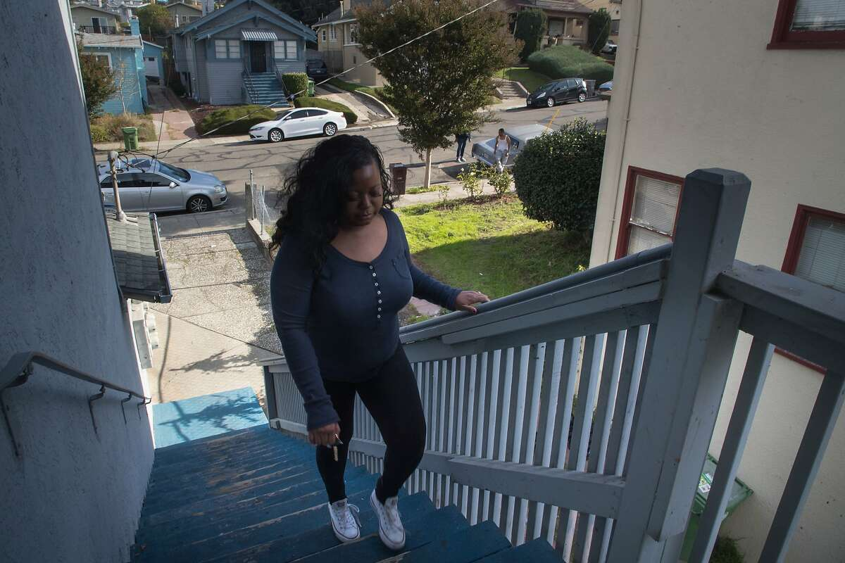 Tri-Nu Little, 38, walks up to her 2-bedroom apartment on Wednesday, Nov. 22, 2017 in Oakland, CA.