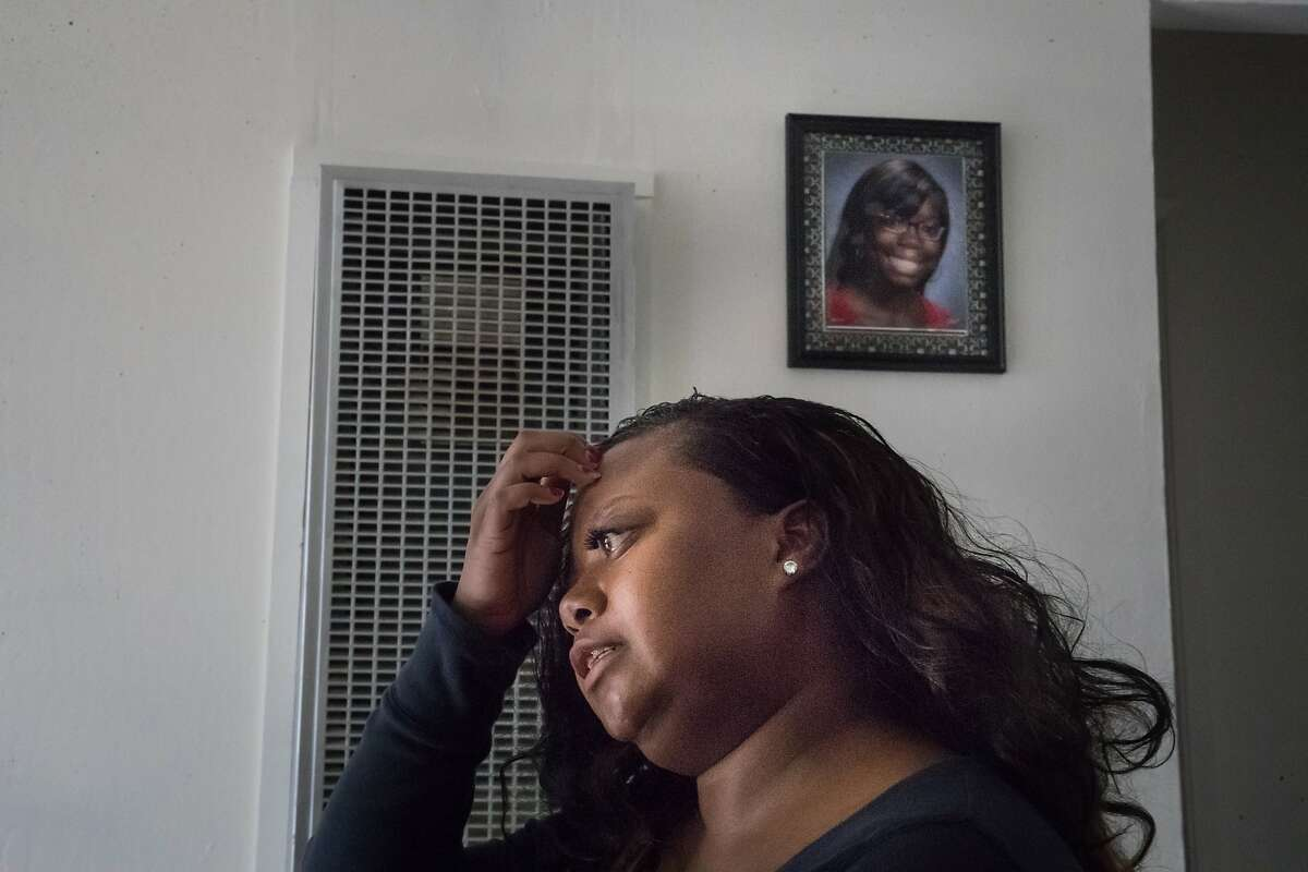 Tri-Nu Little, 38, talks about her difficult times of homelessness in her 2-bedroom apartment on Wednesday, Nov. 22, 2017 in Oakland, CA. A portrait of her daughter Kei-Nu,18, hangs on the wall.