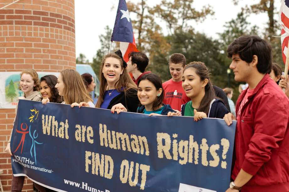 Demme Durrett (center) walks with participants during the Human Rights Walk and Festival at Town Green Park.Since it was founded in 2011, the Human Rights Walk and Festival in The Woodlands has been the largest Human Rights Day celebration in the United States. Photo: Courtesy Photo
