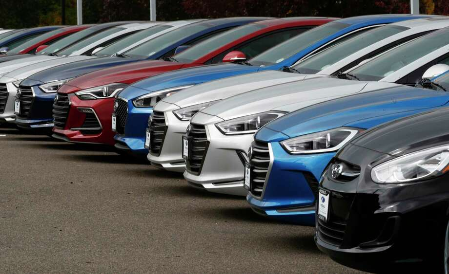 In this Friday, Oct. 6, 2017, photo, a line of 2018 Accents, Elantras and Sonatas sit at a Hyundai dealership in the south Denver suburb of Littleton, Colo. On Friday, Dec. 1, 2017, automakers report U.S. sales of new vehicles in November. (AP Photo/David Zalubowski) Photo: David Zalubowski, STF / Copyright 2017 The Associated Press. All rights reserved.