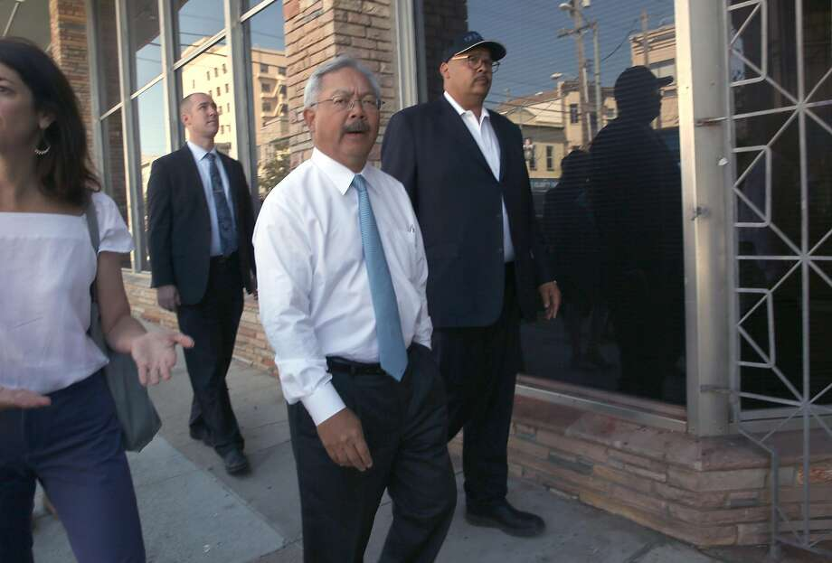 Mayor Ed Lee (middle) takes an outside street tour of the the latest Navigation Center, a one-stop comprehensive shelter aimed at quickly housing the homeless, on Sunday, July 16, 2017 in San Francisco, Calif. Photo: Liz Hafalia, The Chronicle