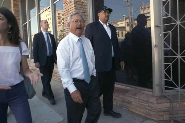Mayor Ed Lee (middle) takes an outside street tour of the the latest Navigation Center, a one-stop comprehensive shelter aimed at quickly housing the homeless, on Sunday, July 16, 2017 in San Francisco, Calif.