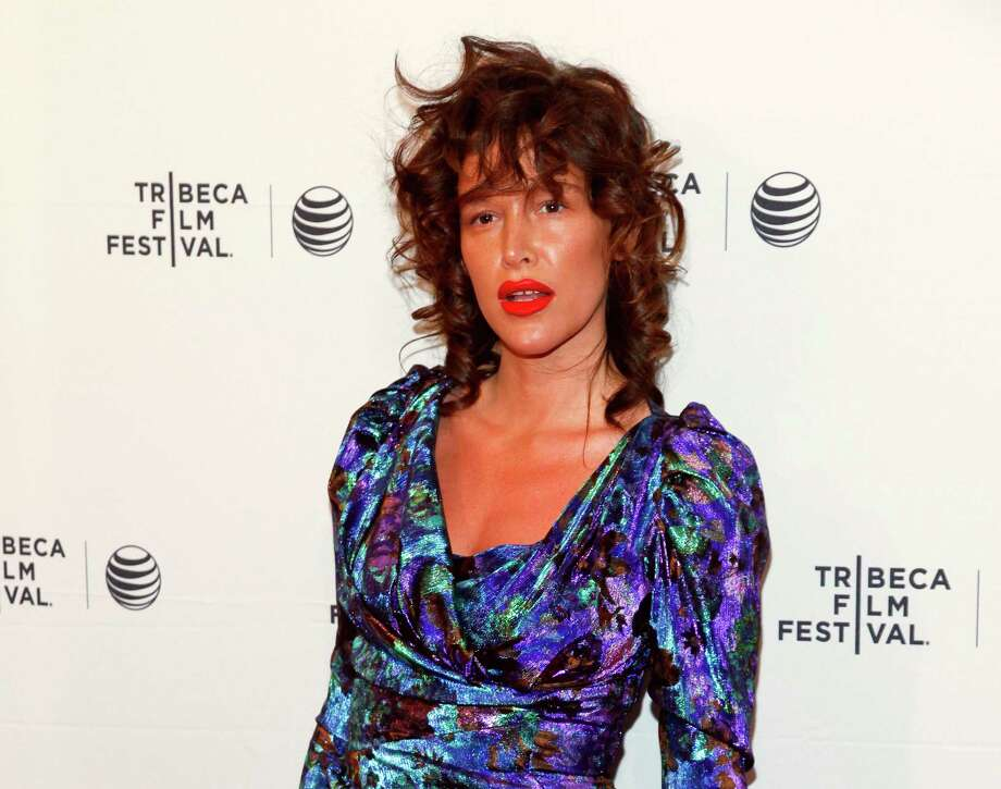 "FILE - In this April 19, 2015 file photo, Paz de la Huerta attends the Tribeca Film Festival world premiere of ""Bare"" at the SVA Theatre in New York.  The lawyer for de la Huerta, who accused Harvey Weinstein of rape said Friday, Dec. 1, 2017,  that she is frustrated prosecutors have not yet brought criminal charges.  The ""Boardwalk Empire"" actress publicly accused the movie producer of raping her twice in 2010. She began speaking with police about the accusation in late October. (Photo by Andy Kropa/Invision/AP, File) ORG XMIT: NY121 Photo: Andy Kropa / Invision"