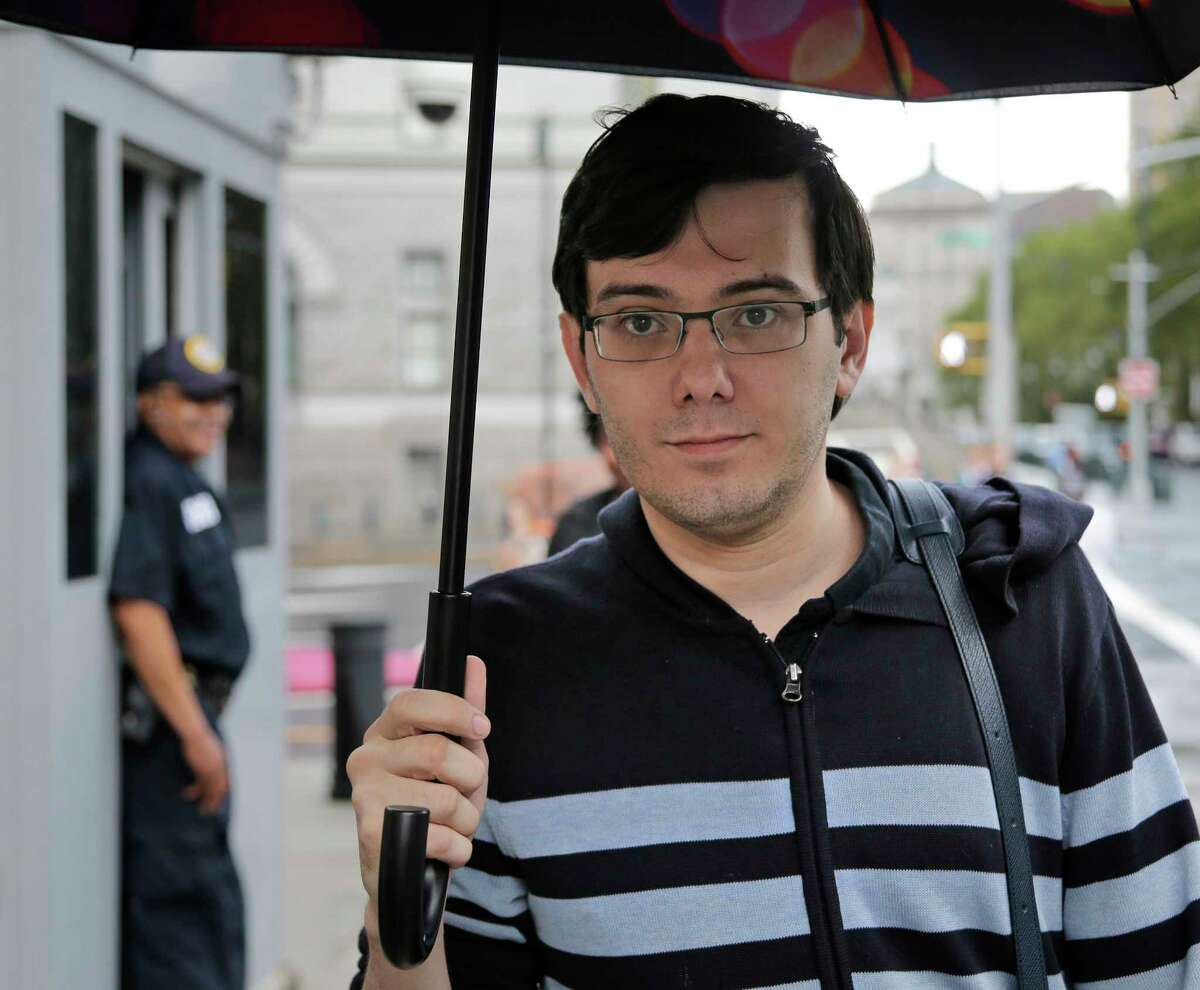 FILE- In this Aug. 4, 2017 file photo, Martin Shkreli arrives at federal court in New York, for the fifth day of deliberations at his securities fraud trial. The government wants to seize Shkreli's one-of-a-kind Wu-Tang Clan album as one of the assets prosecutors argue the jailed former pharmaceutical CEO should forfeit as part of the $7.3 million in fines he owes as a result of his conviction. (AP Photo/Seth Wenig, File) ORG XMIT: NYR101
