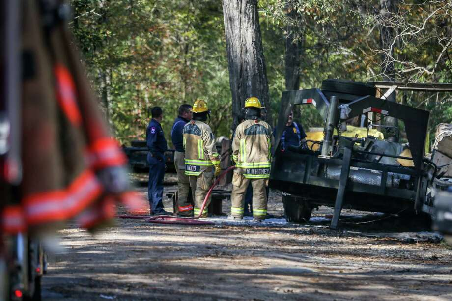 Emergency services respond to the scene where a vehicle exploded, seriously burning a man on Friday, Dec. 1, 2017, on Crystal Creek in Cut and Shoot. Photo: Michael Minasi, Staff Photographer / © 2017 Houston Chronicle