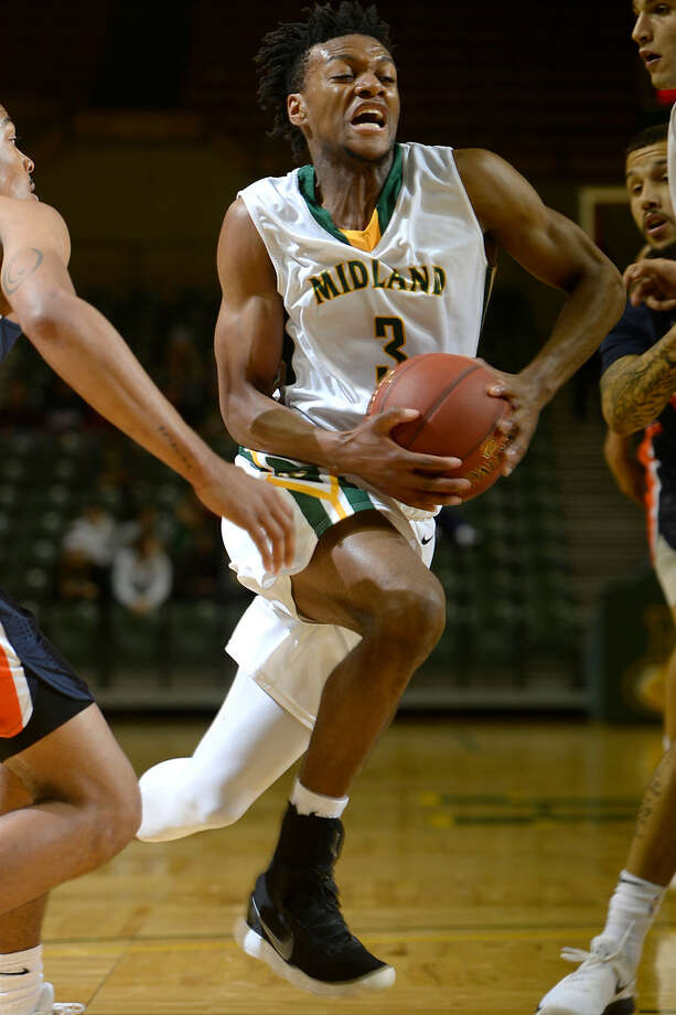 Midland College's Kevin Kangu (3) makes a break for the hoop against South Plains College on Nov. 29, 2017, at Chaparral Center. James Durbin/Reporter-Telegram