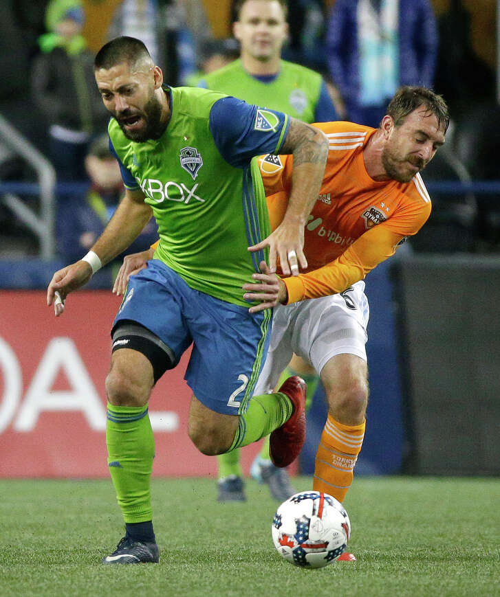Dynamo midfielder Eric Alexander, right, battling Seattle Sounders FC midfielder Clint Dempsey, is a free agent and can talk to any MLS club.