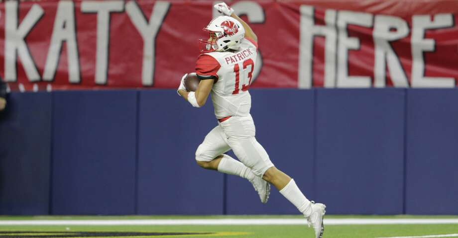 Katy Tigers wide receiver Jordan Patrick (13) scores a touchdown in the second quarter during the high school football playoff game between the Atascocita Eagles and the Katy Tigers at NRG Stadium in Houston, TX on Saturday, December 1, 2017. Photo: Tim Warner/For The Chronicle