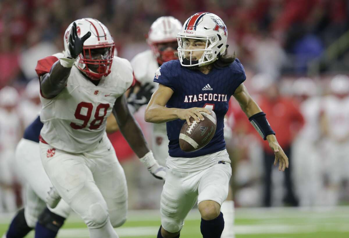 Atascocita Eagles quarterback Jack Roe (4) is forced to scramble pressured by Katy Tigers Moro Ojomo (98) during the high school football playoff game between the Atascocita Eagles and the Katy Tigers at NRG Stadium in Houston, TX on Saturday, December 1, 2017.