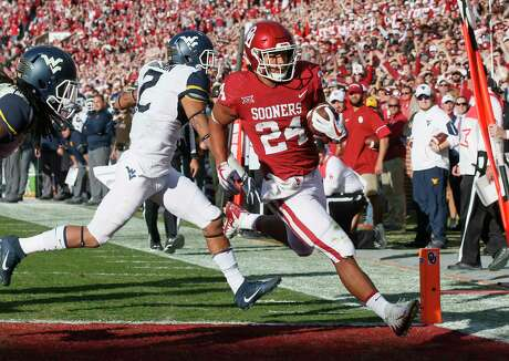 Oklahoma running back Rodney Anderson, right, gave TCU fits in their first matchup, rushing for 151 yards and racking up 139 yards receiving en route to four touchdowns.