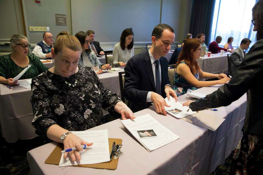 Contestants gather their application paperwork after taking a test during Jeopardy auditions at The Westin Oaks Houston at the Galleria on Friday, Dec. 1, 2017, in Houston. (Annie Mulligan / Freelance) Photo: Annie Mulligan, Freelance / @ 2000 Annie Mulligan