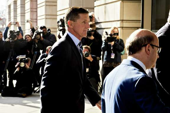 Michael Flynn, former U.S. national security adviser, left, arrives at the U.S. Courthouse in Washington on Friday. Flynn pleaded guilty Friday morning to lying to federal agents regarding contacts with Russian officials.