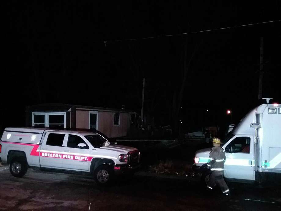 Emergency vehicles at the scene of a fatal Shelton fire on Friday night. Photo: Christian Abraham / Hearst Connecticut Media