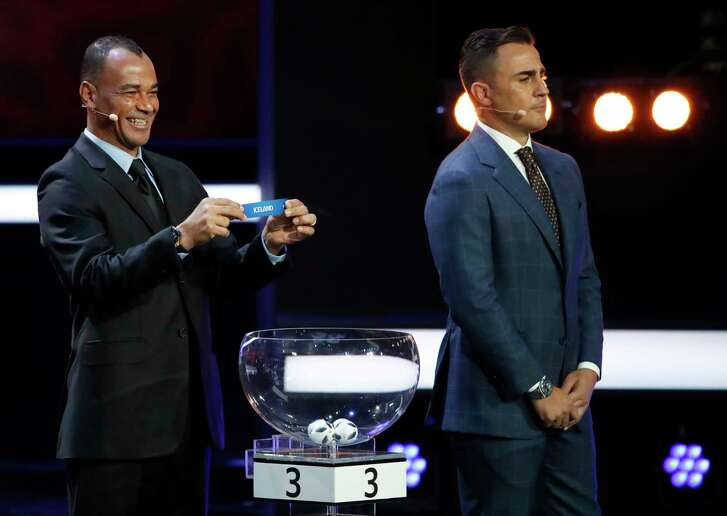 The eight groups of the 2018 World Cup were drawn Friday, including Brazil, home to soccer star Cafu, left, but missing Fabio Cannavaro's native country of Italy for the first time since 1958.