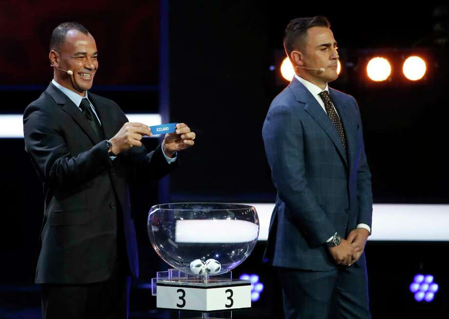 The eight groups of the 2018 World Cup were drawn Friday, including Brazil, home to soccer star Cafu, left, but missing Fabio Cannavaro's native country of Italy for the first time since 1958. Photo: Pavel Golovkin, STF / Copyright 2017 The Associated Press. All rights reserved.