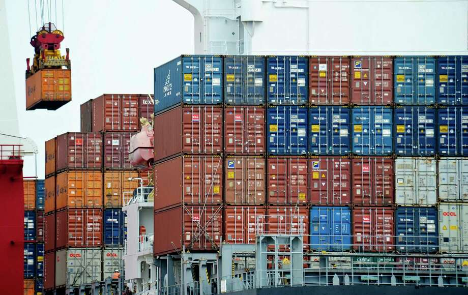 "FILE - In this Aug. 5, 2010, file photo, a container is loaded onto a cargo ship at the Tianjin port in China. The United States is joining a fight against China at the World Trade Organization in a decision likely to ratchet up tensions between Washington and Beijing. The U.S. is supporting the European Union in a dispute over China's status at the WTO. The United States and EU contend that the Chinese government continues to interfere so heavily in the country's commerce that China remains a ""non-market'' economy. (AP Photo/Andy Wong, File) Photo: Andy Wong, STF / Copyright 2017 The Associated Press. All rights reserved."