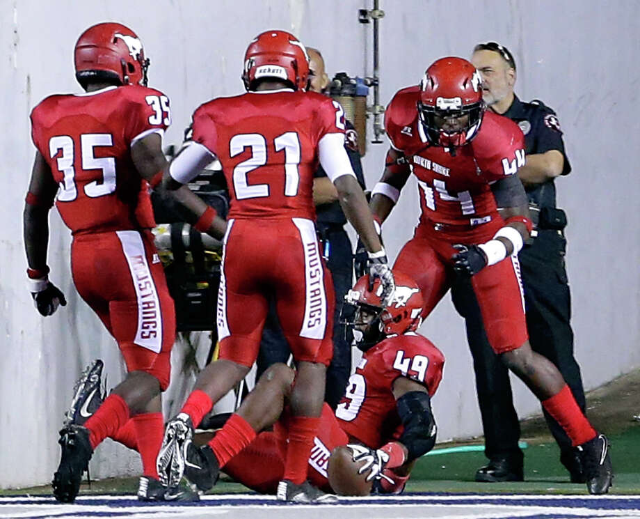 PHOTOS: North Shore vs. LamarNorth Shore's Jacoby Allen (49) is surrounded by celebrating teammates Lou'Von Coleman (35), Kevin Gilliam (21) and Jeremiah Walter (44) after Allens score on an interception during the first half of their regional semi-final game against Lamar at Rice Stadium in Houston, TX, Dec. 1, 2017 (Michael Wyke / For the  Chronicle) Photo: Michael Wyke/For The Chronicle