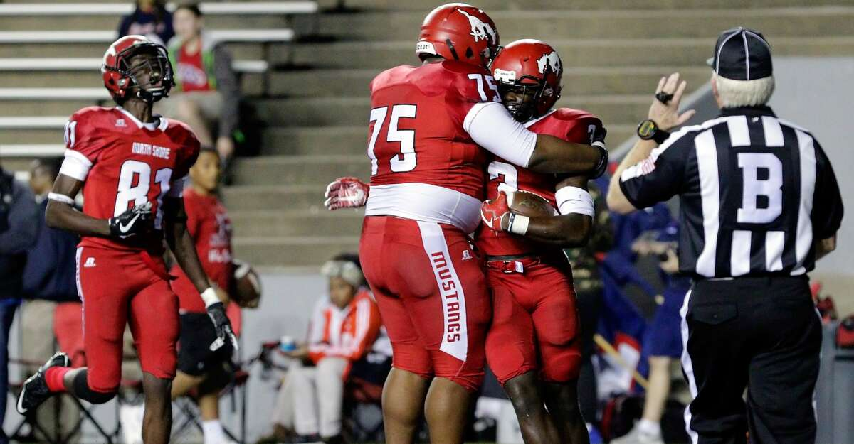 North Shore's Randy Woodard (81) and James Taylor (75) celebrate the touchdown by Zach Evans (3) during the first half of their regional semi-final game against Lamar at Rice Stadium in Houston, TX, Dec. 1, 2017 (Michael Wyke / For the Chronicle)