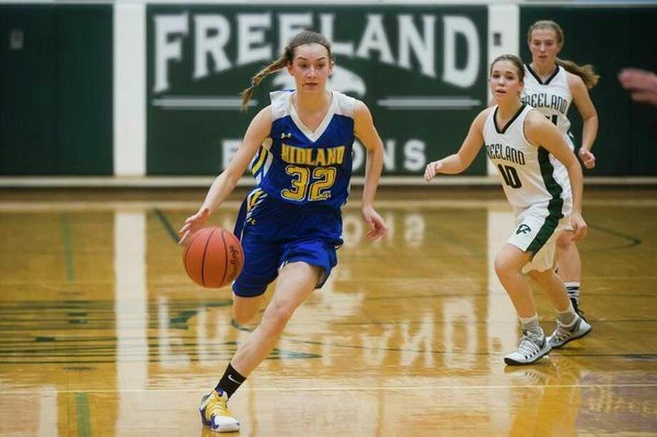 Midland freshman Anna Tuck dribbles toward the basket during a game against Freeland on Friday at Freeland High School. (Katy Kildee/kkildee@mdn.net)