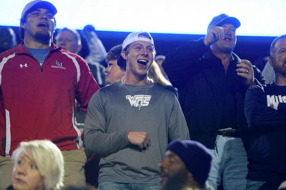 Former West Orange-Stark quarterback Jack Dallas, center, cheers for the team against Madisonville in the regional semifinal at Texan Drive Stadium in Porter on Friday night.  Photo taken Friday 12/1/17 Ryan Pelham/The Enterprise Photo: Ryan Pelham / ©2017 The Beaumont Enterprise/Ryan Pelham