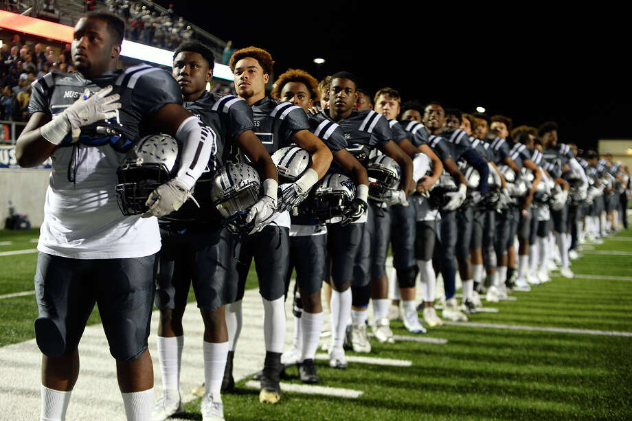 West Orange-Stark players observe the national anthem before playing Madisonville in the regional semifinal at Texan Drive Stadium in Porter on Friday night.  Photo taken Friday 12/1/17 Ryan Pelham/The Enterprise Photo: Ryan Pelham / ©2017 The Beaumont Enterprise/Ryan Pelham