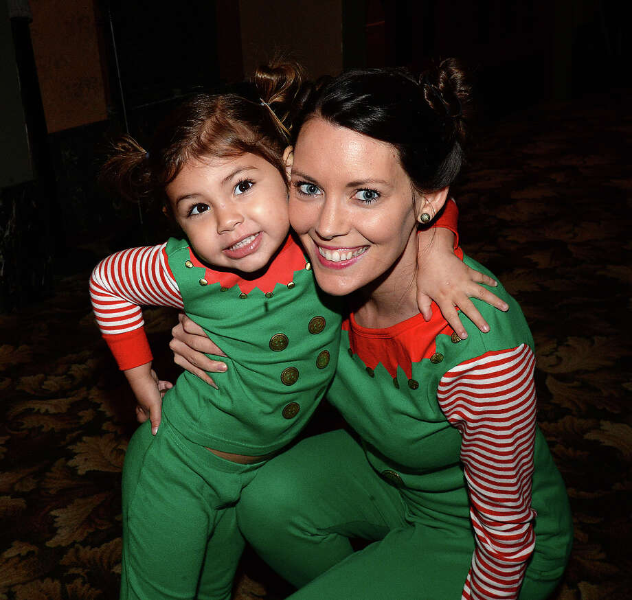 Savannah and Meagan Guidry were at Friday's classic movie night showing of Polar Express at the Jefferson Theatre. The show kicks off a Friday night series of holiday classics leading up to Christmas. Photo taken Friday, December 1, 2017 Kim Brent/The Enterprise Photo: Kim Brent / BEN