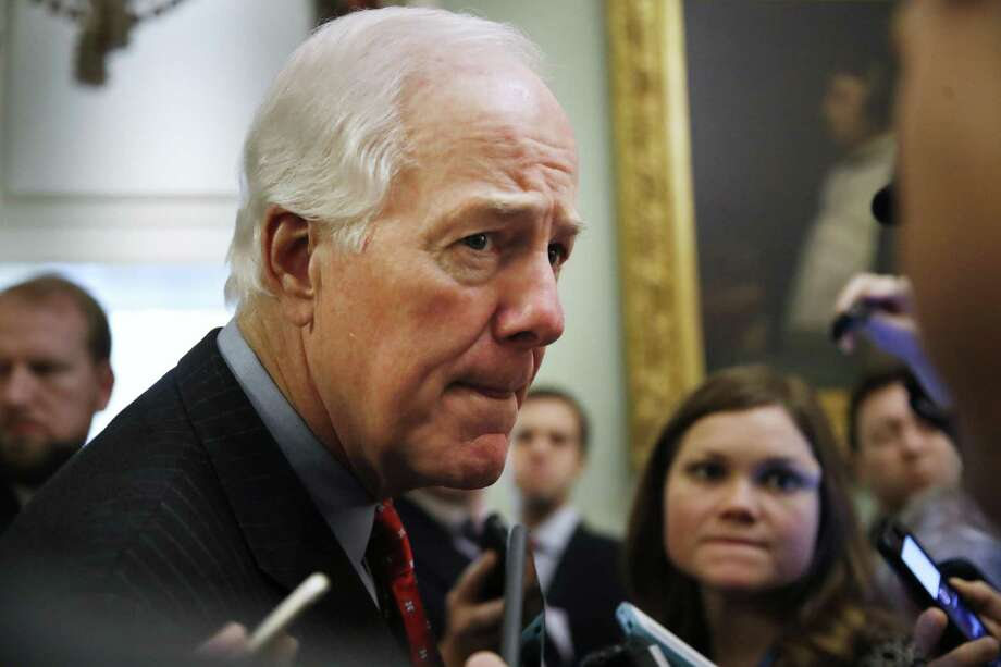 Senate Majority Whip Sen. John Cornyn, R-Texas, listens to a question from a reporter as he leaves the Senate chamber, Friday, Dec. 1, 2017, on Capitol Hill in Washington.  (AP Photo/Jacquelyn Martin) Photo: Jacquelyn Martin, STF / Associated Press / Copyright 2017 The Associated Press. All rights reserved.