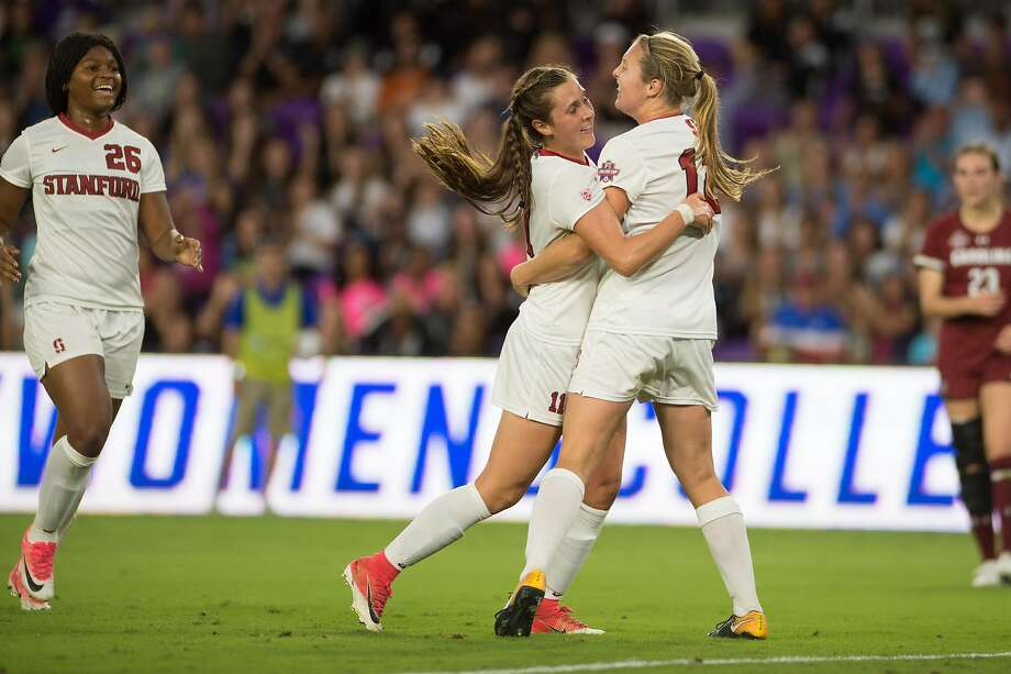 Stanford midfielder Jordan DiBiasi, left,  celebrates her first of two goals with teammate Krya Carusa on Friday night in Orlando. Photo: StanfordPhoto