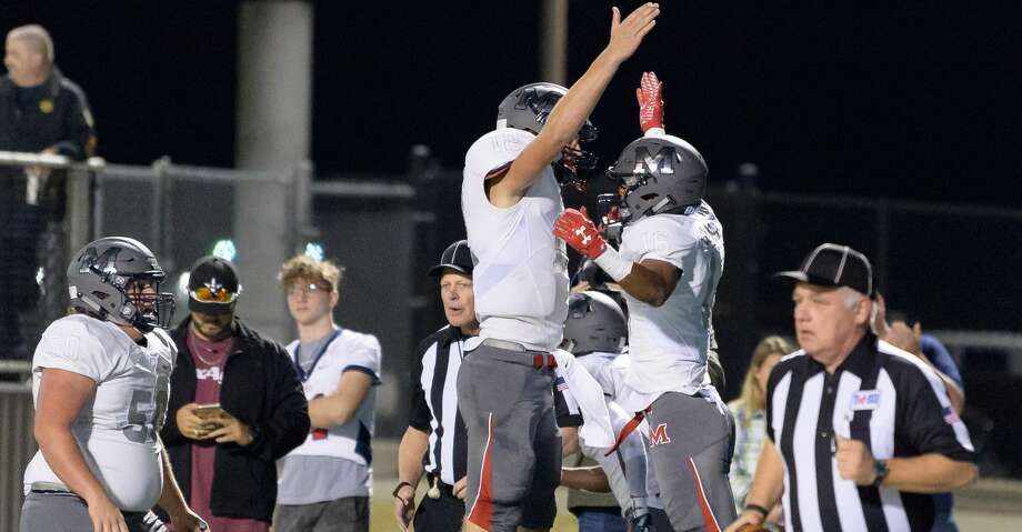 Warren Laster (16) of the Manvel Mavericks celebrates his touchdown in the first half with Kason Martin (12) against the Cedar Park Timberwolves in a high school football game on Friday, December 1, 2017 at Waller ISD Stadium in Waller Texas. Photo: Wilf Thorne/For The Chronicle