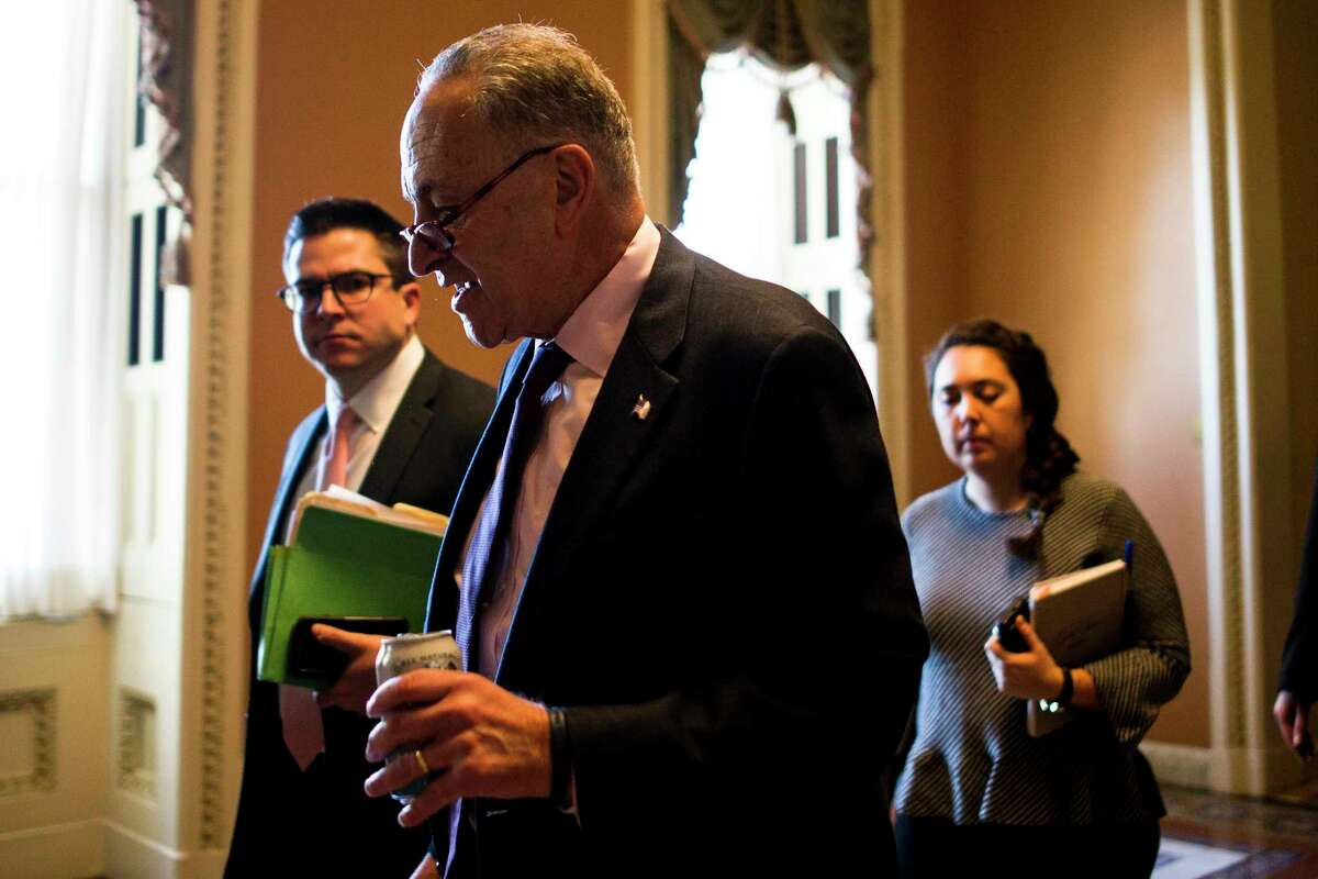 Senate Minority Leader Chuck Schumer,(D-N.Y.) speaks with reporters on Capitol Hill in Washington, Dec. 1, 2017. Republican leaders said on Friday that they have enough votes to pass the Republican tax bill along party lines after last-minute changes brought wavering senators on board. (Justin Gilliland/The New York Times)