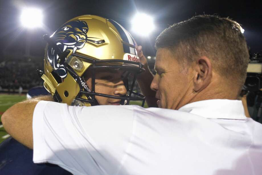 O'Connor's Head Coach David Malesky hugs quarterback Roel Sanchez after beating San Benito on Friday, December 1, 2017 at Buccaneer Stadium in Corpus Christi Photo: Charlie Blalock/ Special To The Express News