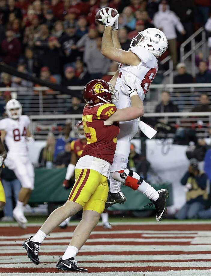 Stanford tight end Kaden Smith, top, catches a touchdown pass over Southern California linebacker Cameron Smith during the second half of the Pac-12 Conference championship NCAA college football game in Santa Clara, Calif., Friday, Dec. 1, 2017. (AP Photo/Marcio Jose Sanchez) Photo: Marcio Jose Sanchez, STF / Copyright 2017 The Associated Press. All rights reserved.