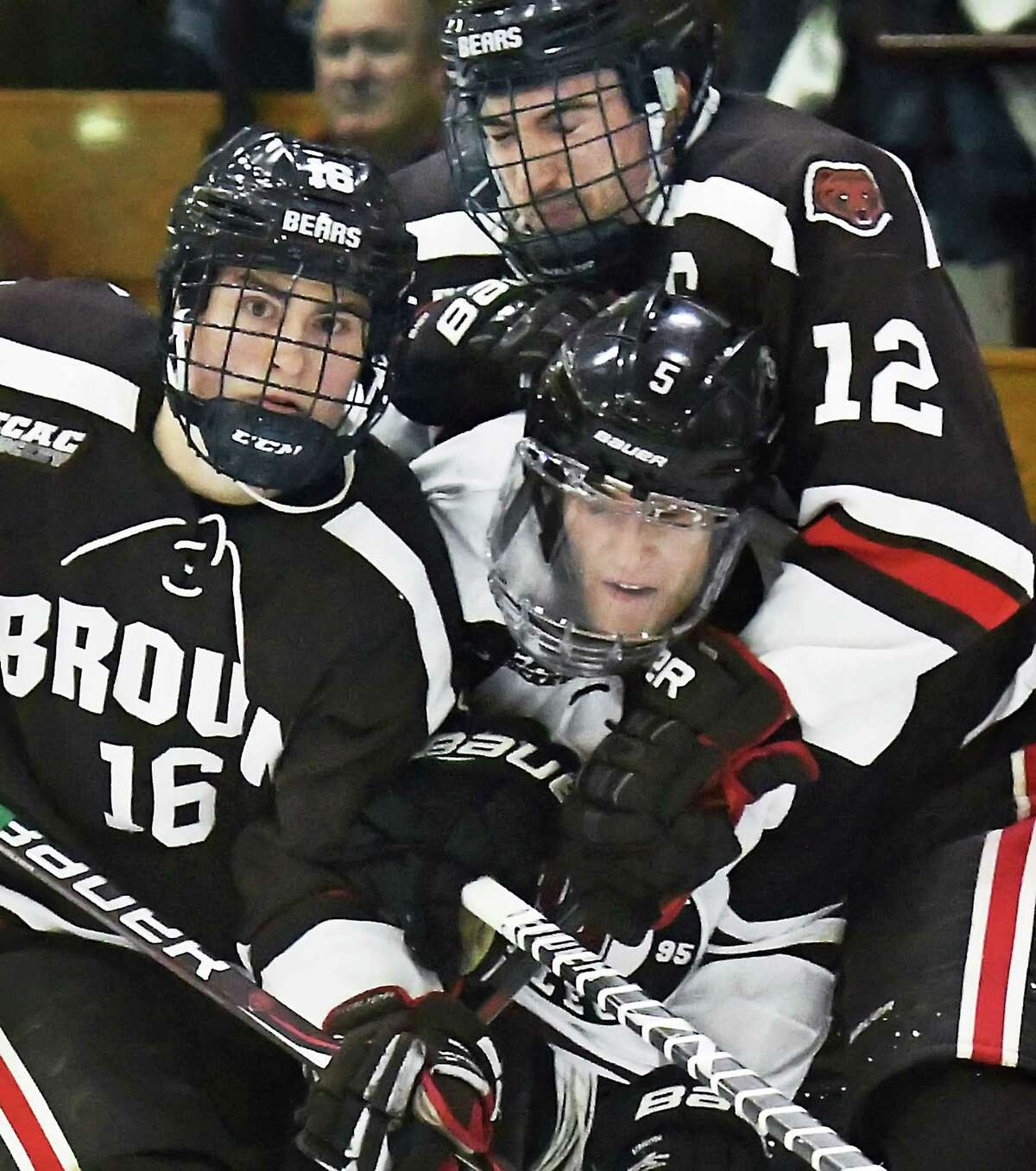 Union's #5 Vas Kolias gets double teamed by Brown's #16 Charlie Corcoran, left, and #12 Josh McArdle, right, during Friday night's game at Messa Rink Dec. 1, 2017 in Schenectady, NY. (John Carl D'Annibale / Times Union)
