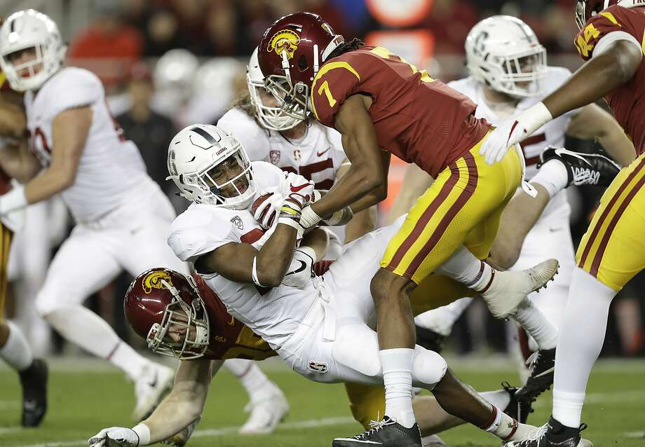 Stanford running back Bryce Love, center, is tackled by Southern California defenders during the first half of the Pac-12 Conference championship NCAA college football game in Santa Clara, Calif., Friday, Dec. 1, 2017. (AP Photo/Marcio Jose Sanchez) Photo: Marcio Jose Sanchez, Associated Press