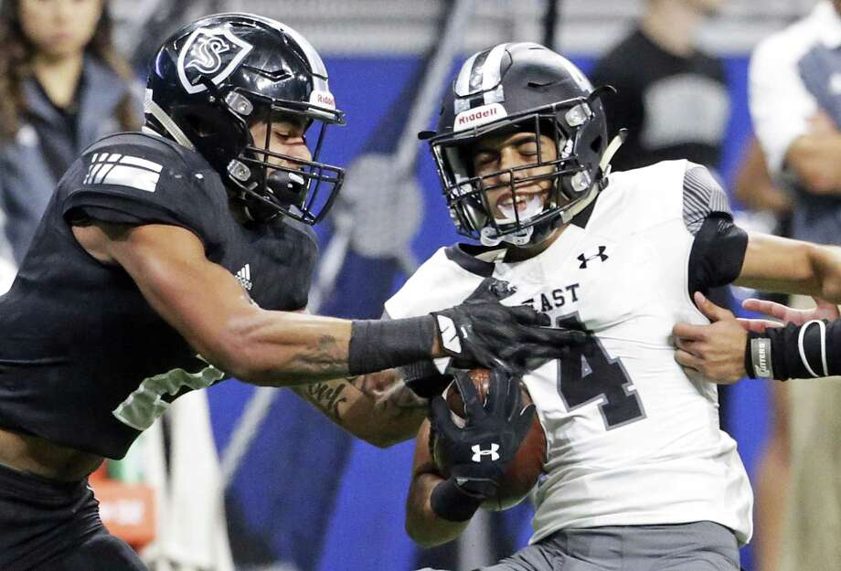 Knight defensive back Caden Sterns tries to take the ball away from Ramsey Vasquez on a screen pass as Steele plays Weslaco in third round playoff action at the Alamodome on December 1, 2017 Photo: Tom Reel, Staff / San Antonio Express-News / 2017 SAN ANTONIO EXPRESS-NEWS