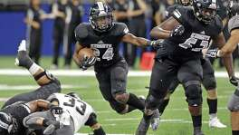 Knight running back De'Quavion Thomas gets behind blocks for a first half gain as Steele plays Weslaco in third round playoff action at the Alamodome on December 1, 2017