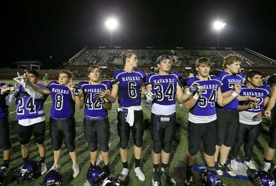 Members of the Navarro Panthers stand during the school song after their Class 4A Division II third-round playoff game against Cuero Friday Dec. 1, 2017 at Heroes Stadium. Cuero won 38-24. Photo: Edward A. Ornelas, Staff / San Antonio Express-News / © 2017 San Antonio Express-News