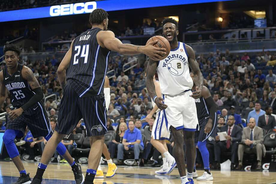 Golden State Warriors forward Jordan Bell (2) celebrates after dunking the ball in front of Orlando Magic center Khem Birch (24) during the second half of an NBA basketball game Friday, Dec. 1, 2017, in Orlando, Fla. The Warriors won 133-112. (AP Photo/Phelan M. Ebenhack) Photo: Phelan M. Ebenhack, Associated Press